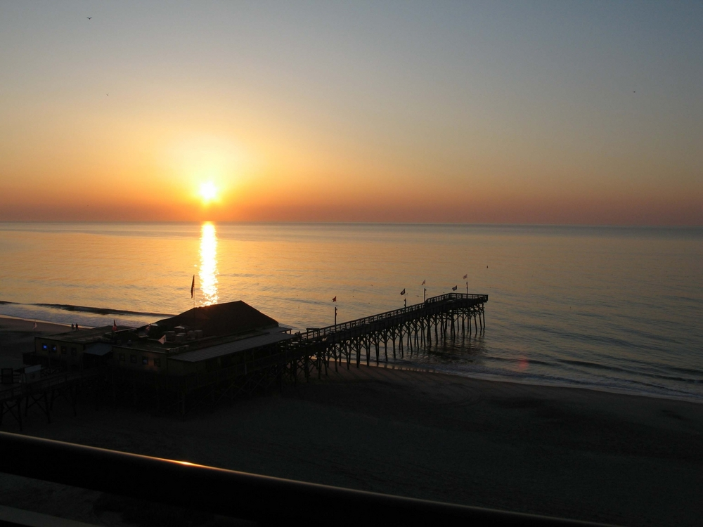 Holiday Pavilion Oceanfront Resort Vacation Rental Condo view of the sunrise over Pier 14