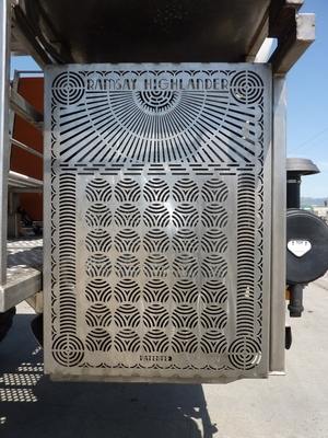 This detailed radiator cover shows off the waterjet cutting capability on stainless sheet.