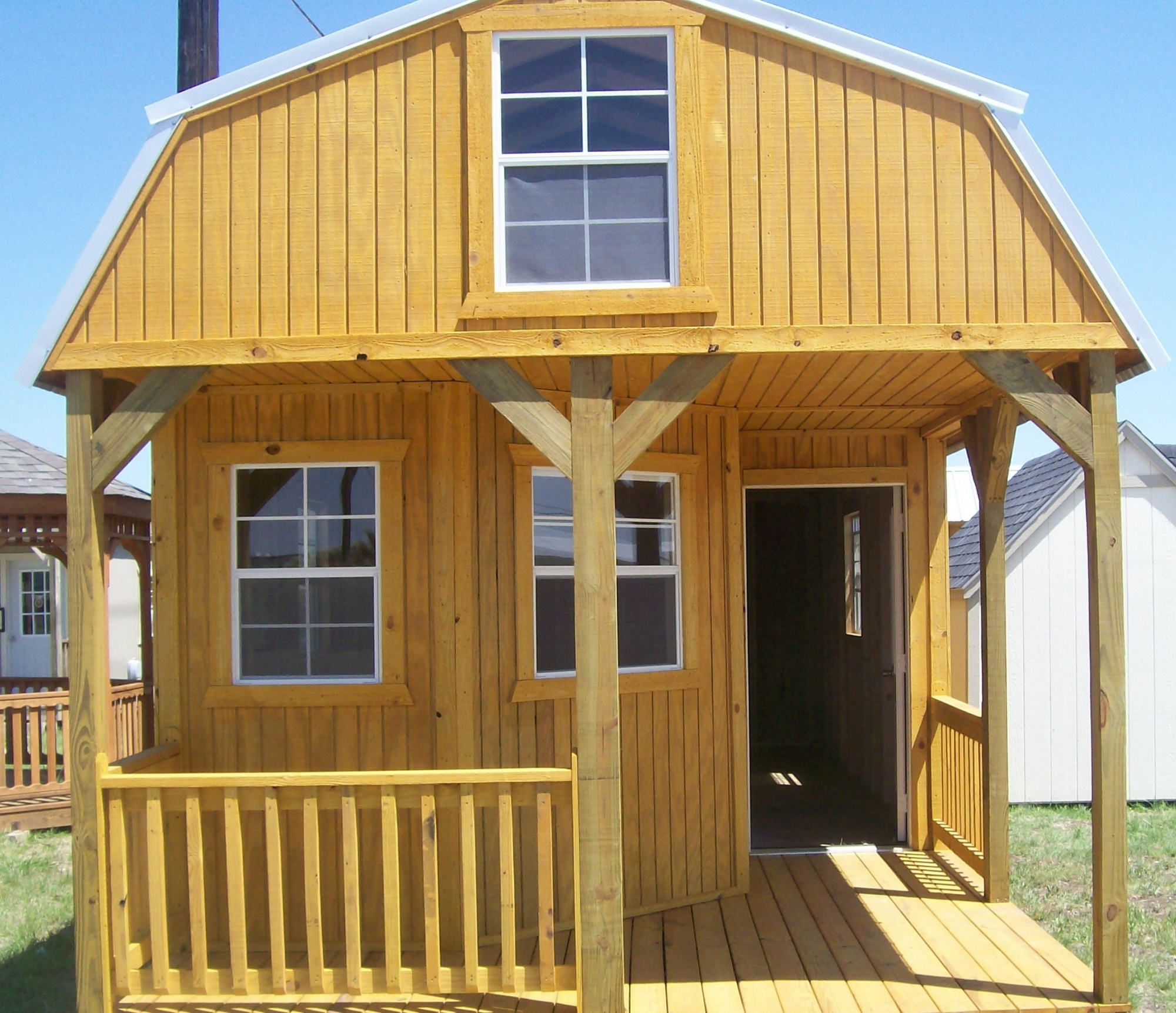 Cabins deluxe cabins lofted barn cabins side lofted barn for Loft cabins