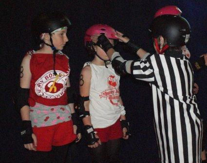 pictured above: Watchmen ref J.D. Rooconducts a pre-bout equipment